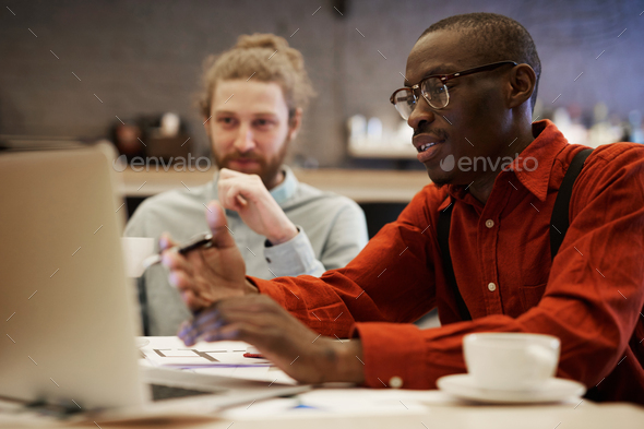 Young African Businessman Using Laptop - Stock Photo - Images