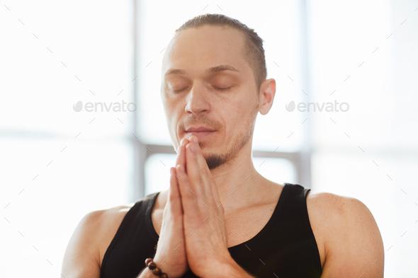 Serene man practicing meditation - Stock Photo - Images