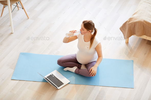 Pregnant Woman Working out at Home Top View - Stock Photo - Images
