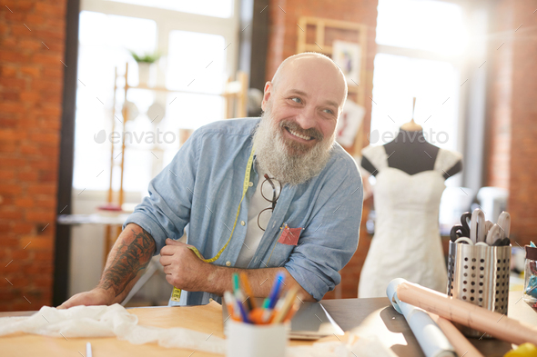 Cheerful tailor - Stock Photo - Images
