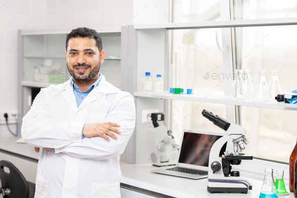 Content young Arabian scientist in laboratory - Stock Photo - Images