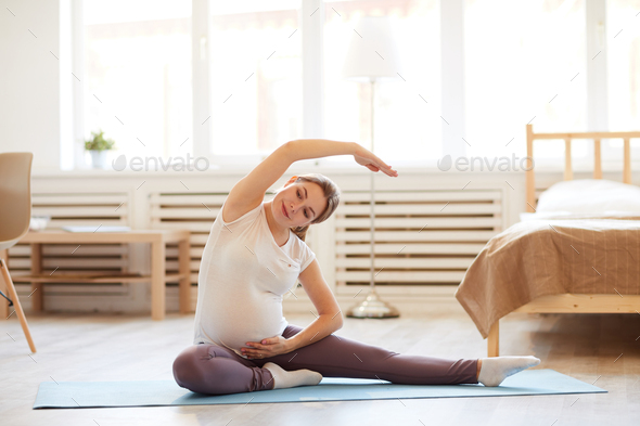 Pregnant Woman Stretching - Stock Photo - Images
