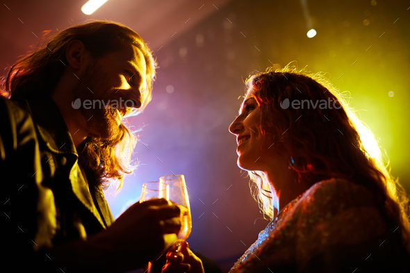 Young people getting acquainted in nightclub - Stock Photo - Images