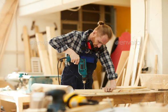 Young Carpenter Working - Stock Photo - Images