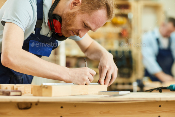 Contemporary Carpenter in Shop - Stock Photo - Images