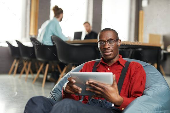African -American Businessman Lounging in Office - Stock Photo - Images