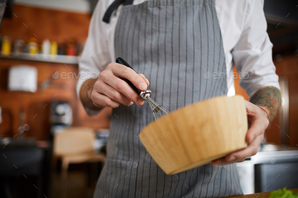 Chef Mixing Eggs - Stock Photo - Images