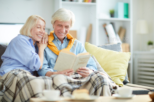 Mature Couple Reading Book - Stock Photo - Images