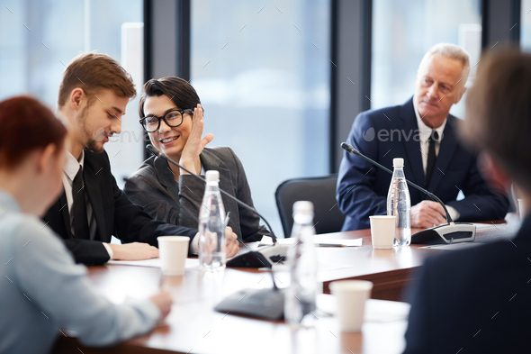 Workers Whispering in Business Meeting - Stock Photo - Images