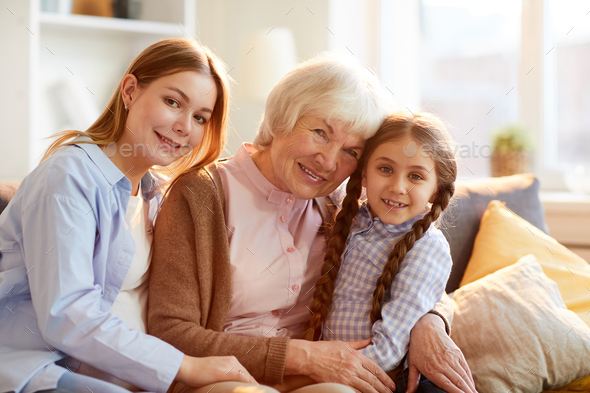 Grandmother Posing with Family - Stock Photo - Images