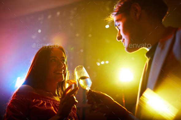 Young couple celebrating anniversary - Stock Photo - Images
