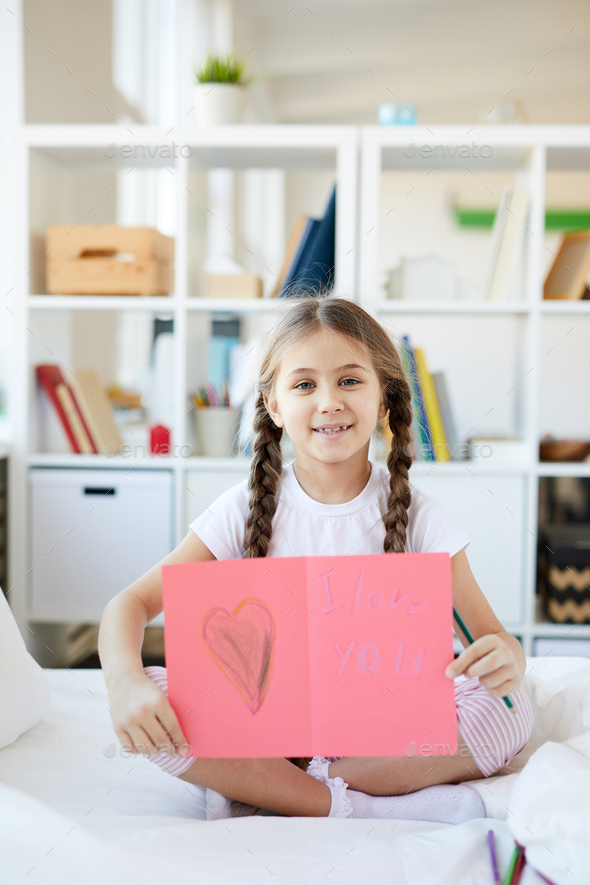 Girl Showing Handmade Card - Stock Photo - Images