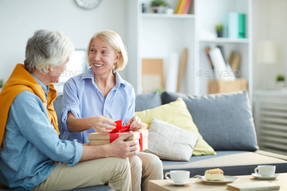 Mature Couple Exchanging Presents - Stock Photo - Images