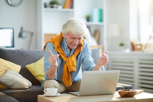 Excited Senior Man Using Laptop - Stock Photo - Images
