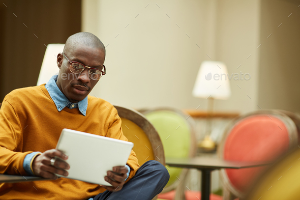 Modern African Man Relaxing in Cafe - Stock Photo - Images