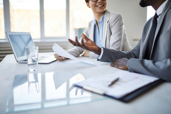 Discussing by table - Stock Photo - Images