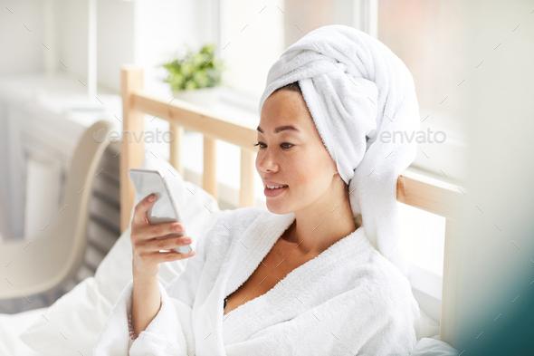 Asian Woman Wearing Bath robe - Stock Photo - Images