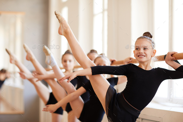 Smiling Girl in Ballet Class - Stock Photo - Images
