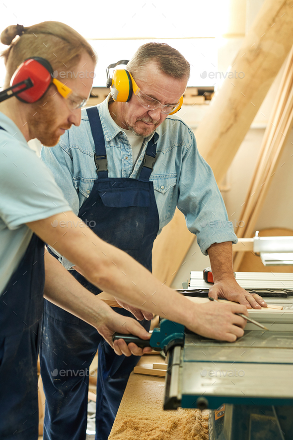 Two Carpenters Cutting Wood - Stock Photo - Images