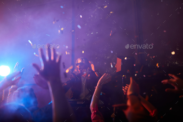 Incendiary atmosphere at performance of dj - Stock Photo - Images