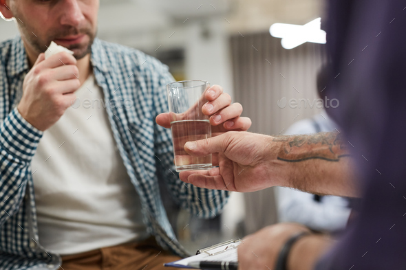 Handing Glass of Water - Stock Photo - Images