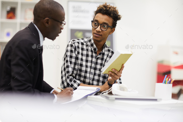 Black guys discussing ideas for project - Stock Photo - Images