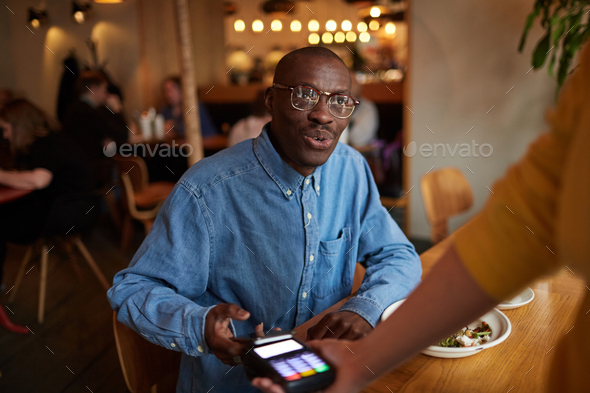 Client Paying in Cafe - Stock Photo - Images