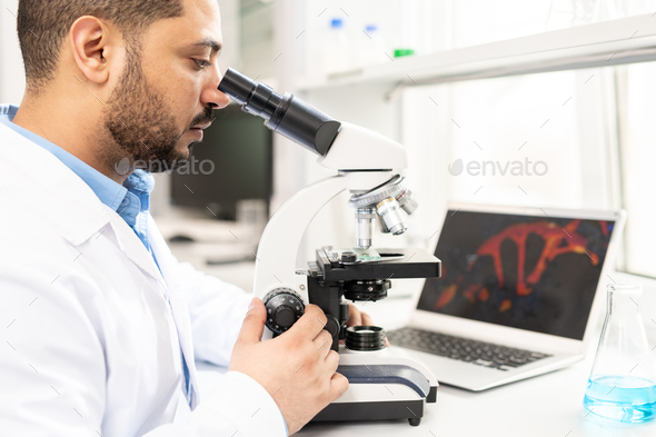 Microbiologist studying organism - Stock Photo - Images