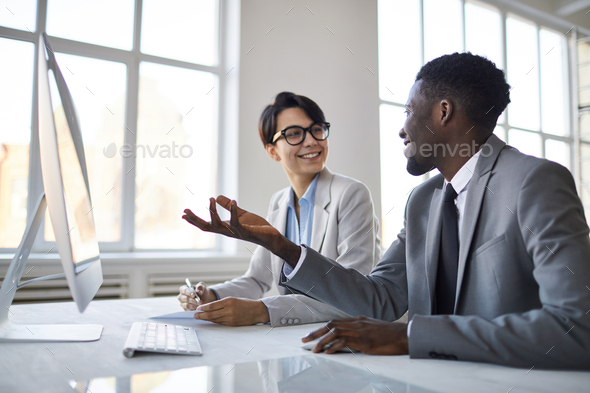 Colleagues discussing data - Stock Photo - Images