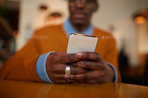Modern African Man Using Smartphone - Stock Photo - Images