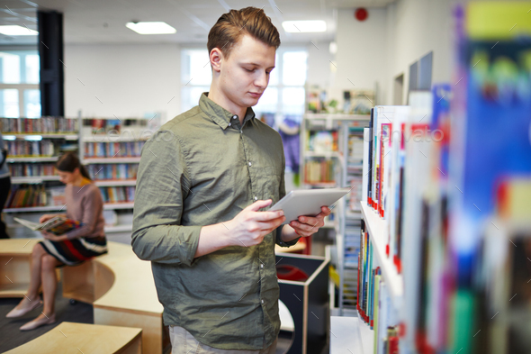 Man in bookshop - Stock Photo - Images