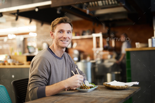 Smiling Man in Chinese Food Restaurant - Stock Photo - Images