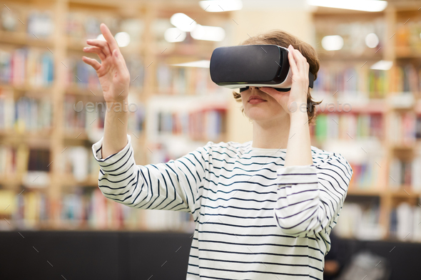 Student using virtual reality goggles - Stock Photo - Images