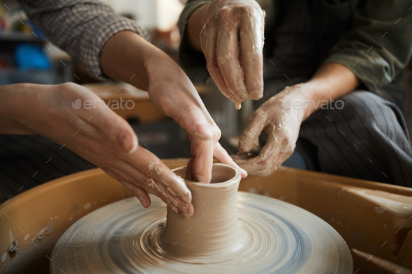 Woman teaching to mould dish from clay - Stock Photo - Images