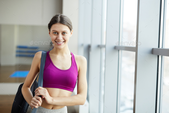 Pretty yoga instructor with yoga mat bag - Stock Photo - Images
