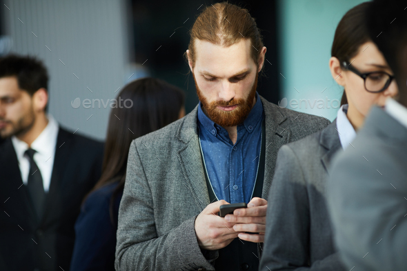 Businessman waiting in line - Stock Photo - Images