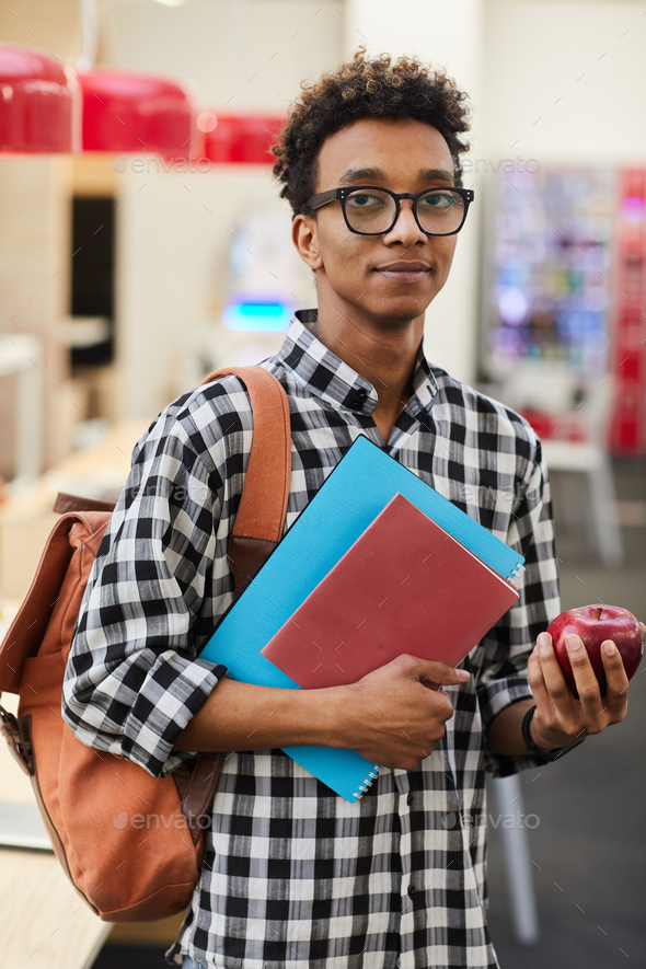 African-American student with apple - Stock Photo - Images