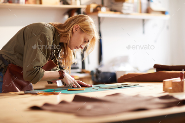 Female  Tailor Working with Leather - Stock Photo - Images