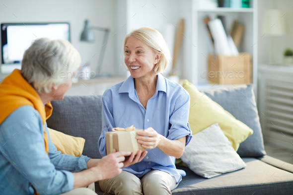 Mature Couple Exchanging Gifts - Stock Photo - Images