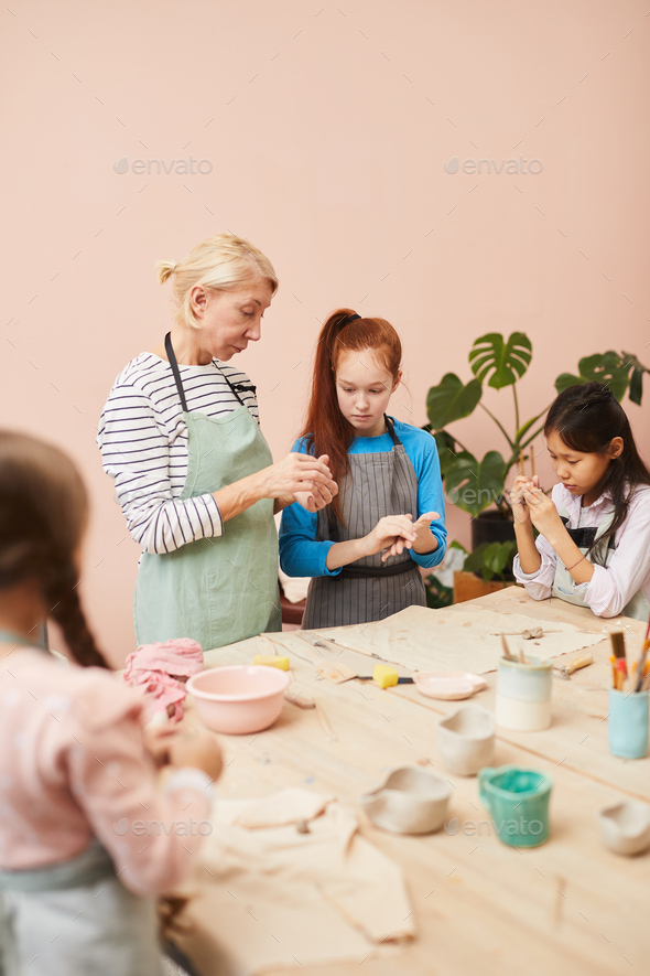 Group of Children in Pottery Class - Stock Photo - Images