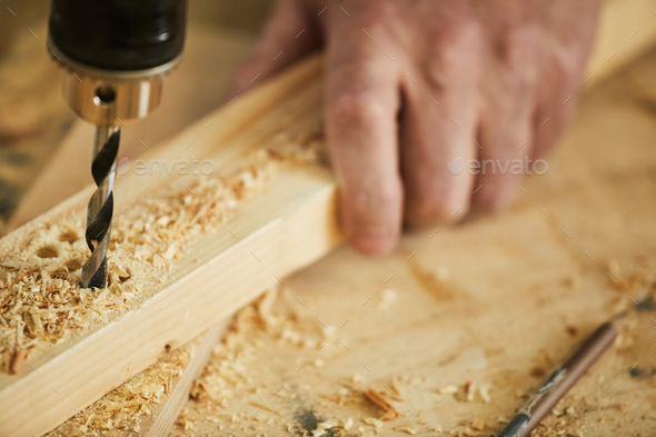 Carpenter Drilling Wood Close up - Stock Photo - Images