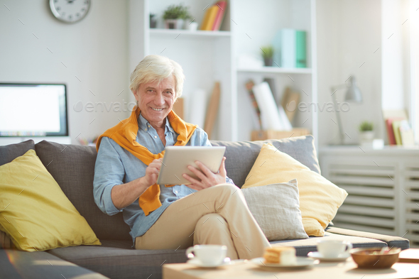 Mature Man Relaxing at Home - Stock Photo - Images