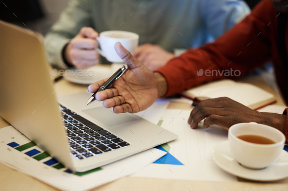 African Businessman Pointing at Screen - Stock Photo - Images