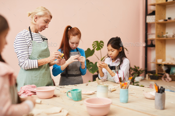 Group of Kids in Pottery Class - Stock Photo - Images