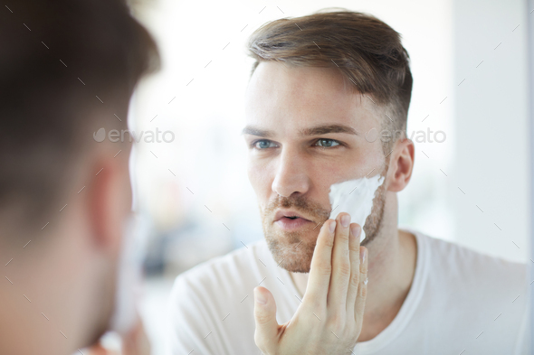 Handsome Man Shaving - Stock Photo - Images