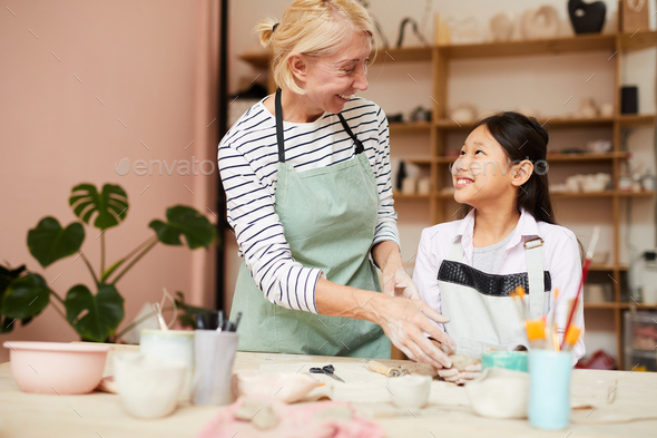 Smiling Asian Girl in Art Class - Stock Photo - Images
