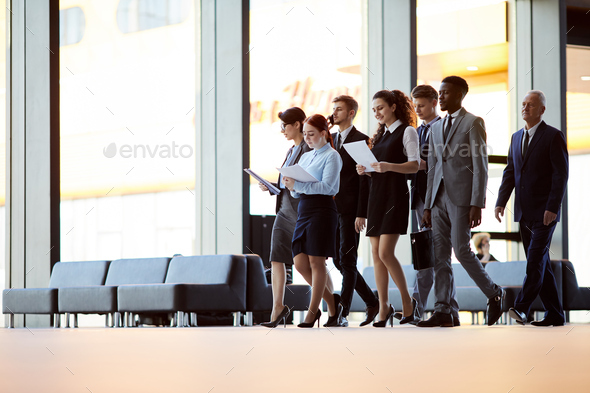 Office Workers Crossing Hall - Stock Photo - Images