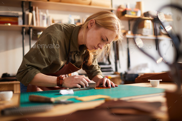 Woman doing Leatherwork - Stock Photo - Images