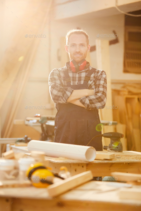 Modern Carpenter Posing in Sunlight - Stock Photo - Images