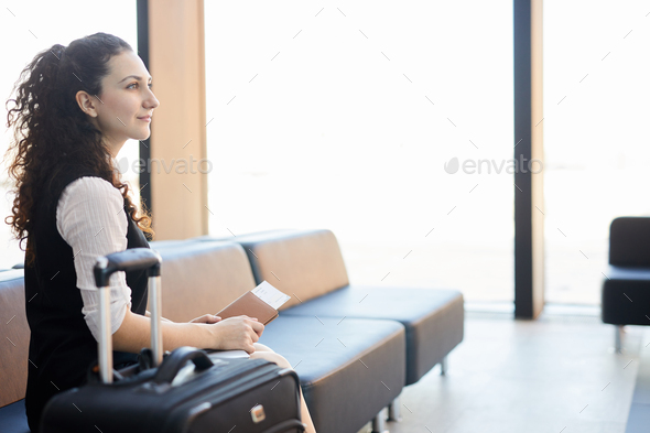 Inspired Traveller in Airport - Stock Photo - Images